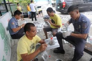 Programme d'installation des ampoules Moser dans un bidonville de Manille.